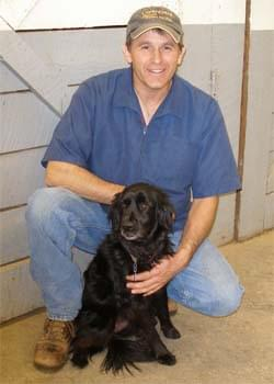 Veterinarian Alan B. Carlson with his dog.